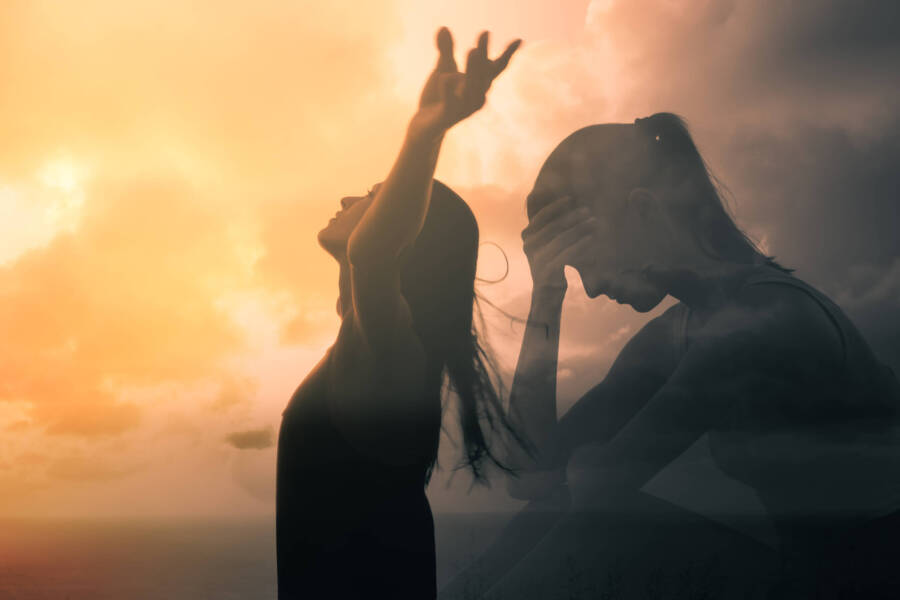 Sad woman becomes happy and free. People letting go of fears, sadness, grief and pain concept.
